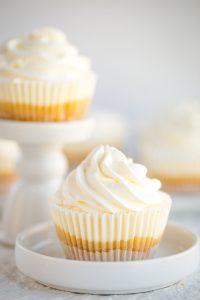 no bake mini lemon cheesecake in cupcake liner on white plate
