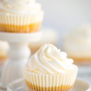 no bake mini lemon cheesecake in cupcake liner on white plate