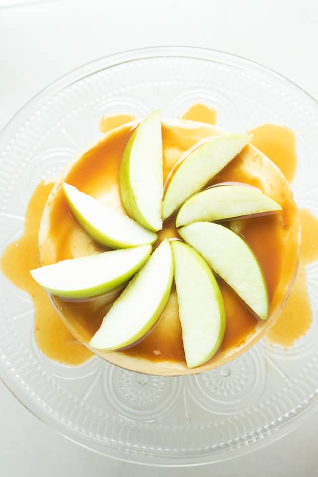 Overhead of instant pot caramel apple cheesecake with apples and caramel on cheesecake
