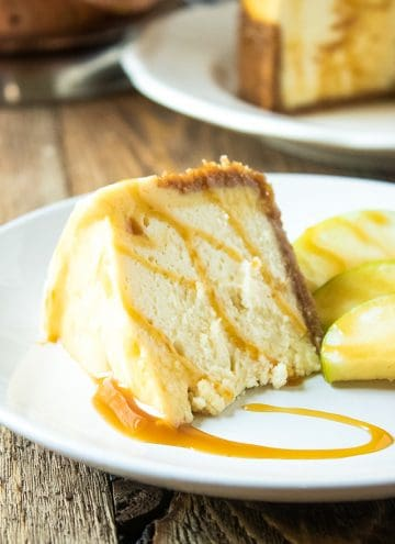 slice of cheesecake with caramel and apples on white plate