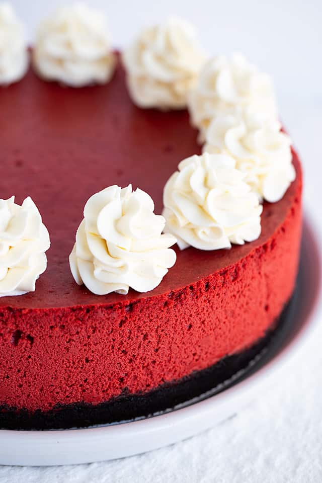 red velvet cheesecake on a white serving plate