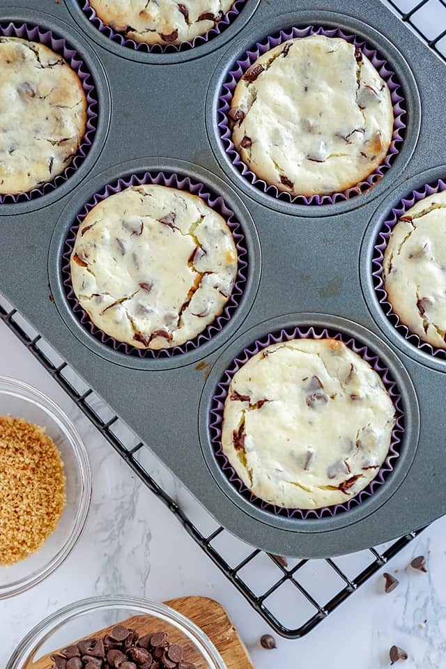 freshly baked cheesecakes in a cupcake pan