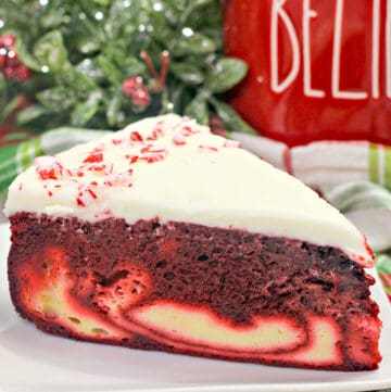 close up photo of cake on a white plate with a red cup behind it